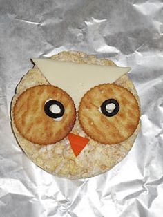 Owl Snacks:  So cute.  Rice cake, Ritz crackers, olives, cream cheese, cheese, and carrot.  Preschool children would love it!
