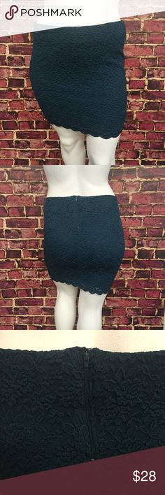 """Torrid Teal Lace Miniskirt Sexy lace miniskirt from torrid! Unique and cool dark teal color. Scalloped lace trim. Zipper on the back with hook and eye. Stretchy waist band. This runs a bit snug or form fitting. Measurements taken laid flat. 18 1/2"""" waist. 19"""" hips. 19"""" long. Shell: 61% polyester. 38% nylon. 1% spandex. Lining: 100% polyester. New with tags, never worn. The tag has a tear though the middle; the skirt is undamaged. Smoke and pet free home. torrid Skirts Mini"""