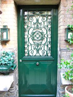 I want to paint my front door this color.   Love it.     Lovely wrought iron detail in this Door