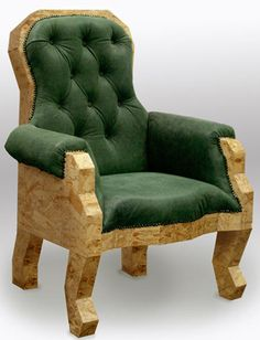 """Rowe used the material, which is made of bonded wooden strips, in his Victorian Grandfather Chair (above) and Chippendale Writing Desk inspired by Chippendale furniture (below). By using OSB and traditional production methods, Rowe says he wants to challenge """"the misconceptions of material aesthetics and the value placed on material"""". """"The Victorian Grandfather Chair combines"""