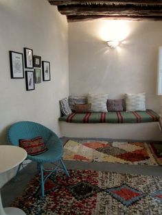 my living room, Essaouira, Morocco...featuring 'boucherouite' rag rugs and vintage Berber pillows.