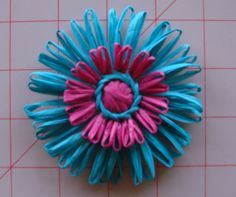I want to make a loom to make VHS tape ribbon flowers.