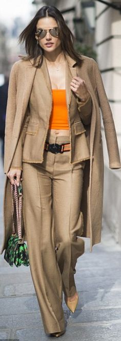 Alessandra Ambrosio's tan coat, brown pants suit, orange belt, cropped top, and…