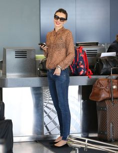 Miranda, Orlando, and Flynn Head Off on Their Next Joint Adventure: Miranda Kerr wore a see-through blouse and skinny jeans.