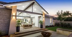 With an impressive raking ceiling that extends from the opulent kitchen into the open dining area and continues to soar through the large alfresco, you'll feel right at home watching the sunset in your backyard. Dream House Plans, Modern House Plans, Modern House Design, Bungalow Floor Plans, Eco Buildings, Alfresco Area, Display Homes, Home Builders, Backyard