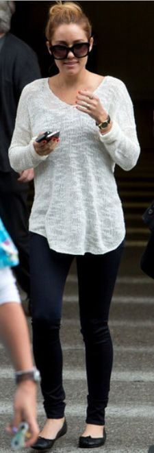 Who made Lauren Conrad's white sweater, black watch, and black sunglasses that she wore at LAX airport on May 2, 2012?