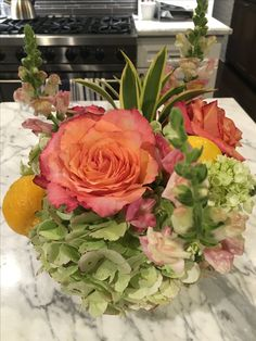Simple floral arrangement to transition into fall! Add hydrangeas, roses, lemons and filler florals in contrasting fall colors. Think yellow, orange, and green. For an extra touch, add lemons into the water at the base of the arrangement.