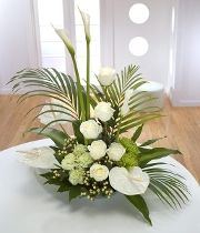 Pure Beauty. A grand design of white Roses, Anthuriums & Calla Lilies.