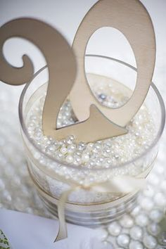what about gold champagne glasses filled with loose pearls?! sooo pretty put 18 instead of 20