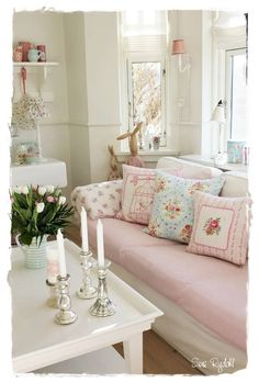 Pastel shabby chic living room of pink and blue.