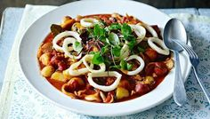 Slow-Cooked Squid and Chorizo Stew by Raymond Blanc. Slow-cooking softens the texture of the squid and brings out its flavours to mingle with the tomato, chorizo and smoked paprika.