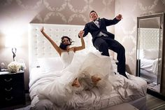 Celebrate your newlywed bliss by jumping on the bed in your hotel…