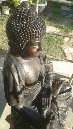 "Buddha in the  ""Gesture of Protection""  (abhaya) or ""fearless mudrâ"""