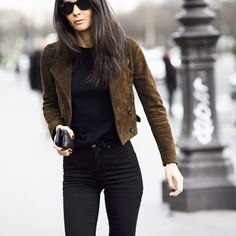 chocolate suede jacket thrown over a black tee and skinny jeans