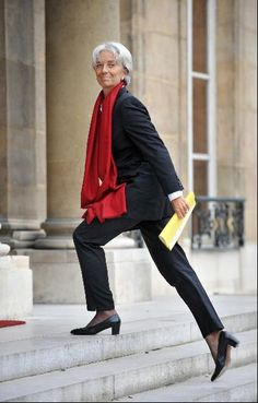 The Most Fashionable Woman In Finance  Executive presence... Suit + Scarf combo very interesting and artfully done.