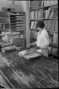 319505PD: Vacuuming incoming records for cleaning and ridding of pests. J.S. Battye Library of West Australian History and State Archives, 1969 https://encore.slwa.wa.gov.au/iii/encore/record/C__Rb3430661
