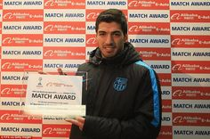 Suarez is presented with his player of the match award after scoring a hat-trick for Barcelona againstGuangzhou Evergrande