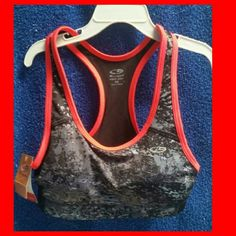 ### NWT~ SPORTS BRA~XS ### Super nice Champion brand sports bra, new with tags. This power core bra offers compression supportive fit, moisture wicking for dry fast, & removable cups for coverage & shape. Size xs, would be great for a teen, preteen, or petite lady. :) Gorgeous black & gray speckled colors are highlighted with pinkish coral colored trim. Great for the gym or simply lounging at home. Intimates & Sleepwear Bras