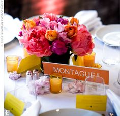 Suerissa and Keith named each table after a street in Brooklyn. Silver elephant holders secured the place cards. The couple chose simple white linen and dishes so the centerpieces would stand out.