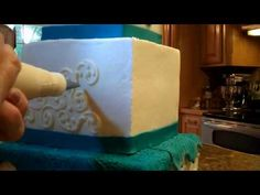 Creating Scrolls on Your Cake by Denise Talbot.  (I could watch piping videos for hours.)