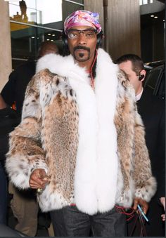 Snoop Dogg wearing a cat lynx jacket with shadow fox tuxedo and trimming on hood while traveling in Paris, France earlier this year.  #fur #furfashion #fashion #snoopdogg #celebrities #alaskanfur #wiw