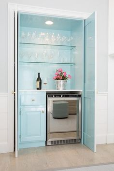 Turquoise blue bar with fold in doors