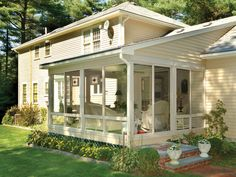 Three-Season Room Screened porches are the quintessential hybrid living room.