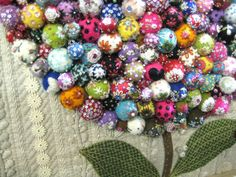 Patchwork masterpieces on display in Japan. These look like felted balls with stitchery on them, on a quilted background with applique leaves. Wow