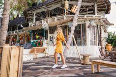 Dancing amongst the La Brisa palm trees in Bared Footwear's Sandpiper sneakers.