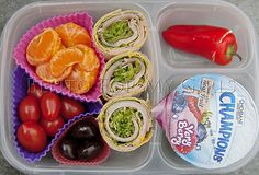 ham/spinach/pea shoot wrap, clementines, grape tomatoes, chocolate covered dried cherries, baby bell pepper stuffed with cream cheese and a Chobani Champions