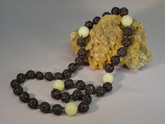 Great Chinese export necklace composed of both celadon green and black jade beads.  Very collectible!