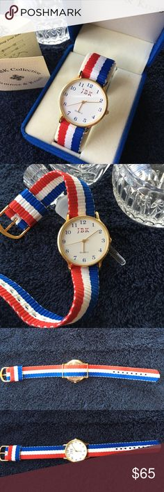 """Jackie Kennedy Collection Patriotic Watch NIB Brand New Battery! JBK jewelry collection patriotic watch NIB by Camrose & Kross. Gold plate finish, white face, second hand, cloth strap, blue numbers in 1 3/8"""" face, gold stem. Pristine condition. Camrose & Kross Jewelry"""