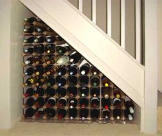 Traditional wine rack under stairs Staircase Storage, Stair Storage, Wine Storage, Under Basement Stairs, Space Under Stairs, Basement Steps, Traditional Wine Racks, Under Stairs Wine Cellar, Wine Cellar Design
