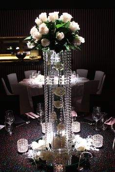 Crystal cascade on vase with white roses #white rose centerpiece #tablescapes #bridaltable #weddingcenterpieces #melbourne #tablescapes  #crystalcenterpieces #weddingcrystal #weddingdecorations #weddingdecor #decoritevents #melbourne #melbourneweddings  www.decorit.com.au (12)