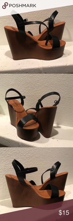 Black strapped wedge heels Never worn wood wedge black strapped heels. 6inch wedge. Never worn. Brand new! Breckelles Shoes Wedges