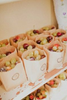 Wedding favors of fresh fruit in a simple brown bag..