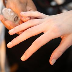 Manicure Idea: Next-To-Nothing Nude Michelle Saunders for Essie created a chalky, soft beige nail at Alexander Wang by layering a nude and a light pink under a matte top coat.