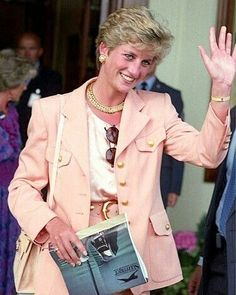 04 July 1993: Princess Diana wave to admirers as she leave Wimbledon stadium in London