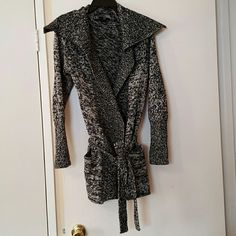 Gap Knitted Wrap Cardigan Beautiful black and white knitted sweater with a wrap around tie around the waist. It has two cute front pockets. It's 49% cotton and 51% Lam's wool. Gently used. GAP Sweaters Cardigans