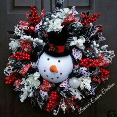 Check out this item in my Etsy shop https://www.etsy.com/listing/253141756/snowman-deco-mesh-wreath-red-white-black