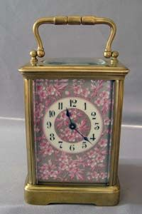 stock number 3909   Antique porcelain panelled French carriage clock with apple blossom decoration.