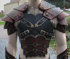 Ornate gothic leather armor set with matching greaves