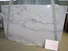 Calacatta White Macabus quartzite. Looks so much like marble. I love it.
