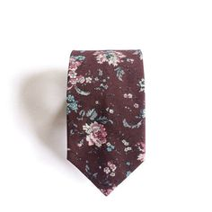 A great groom fashion detail is a patterned tie. It's a chance to add some personality to an otherwise formal groom's suit ensemble, and reflects well on the trendiness of the leading man.