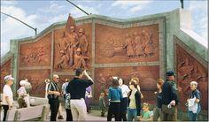 20th CENTURY VETERANS MEMORIAL. 16' x 60' 8 panel exterior custom brick mural North Platte Veterans Memorial in North Platte, Nebraska. Sculpture by artist Jay Tschetter.
