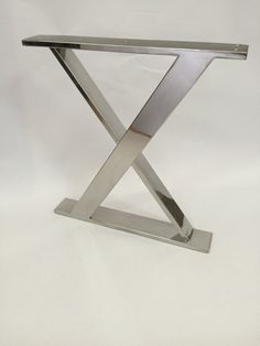 Polished Stainless Steel X Frame legs. Height : 13,9763inch / 355mm Width : 13,3858 / 340mm Stainless steel square tube : 10 / 50mm Please let me know if you need custom sizes. There are 5 holes on the top to connect base to furniture with bolts. This glossy finish X frame legs would