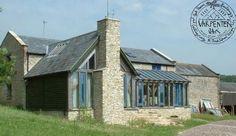 Barn conversion in Lyme Regis by Roderick James Architects with oak frame by Carpenter Oak Ltd