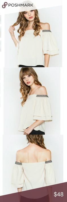 "COMING SOON!  Juliana Off The Shoulder Top Comment below with size to reserve yours This flirty off the shoulder top is meant for stylish and chic ladies!  The double layered ruffle sleeve adds a romantic look to it that's perfect for date night!  *Elastic top *Partially lined *Color: Beige *Length: 17.75"" *100% polyester Tops"
