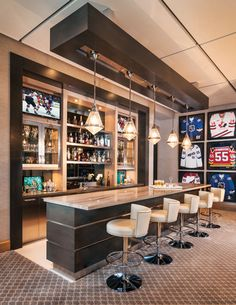 One Design Team Creates An Indoor-Outdoor Waterfront Home With A Striking Caribbean Edge For The Family Of Professional Hockey Player Ed Jovanovski. Jersey Wall TV Party Room Ultimate Sports bar. Man cave Woman Cave