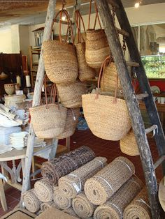 Ladder with rugs and natural bags